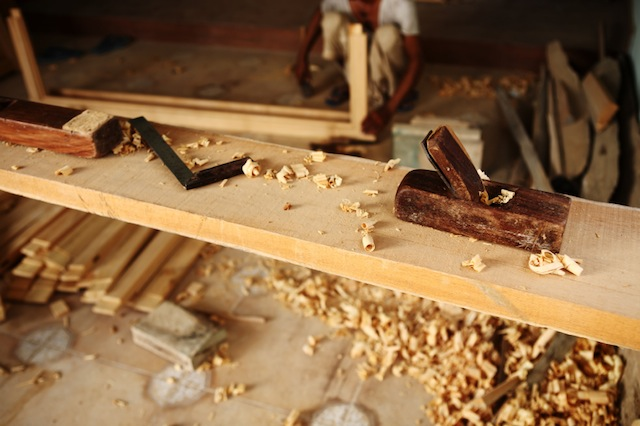 Block Plane and other Carpentry tools on Teak Wood Plank in Carpenter Workshop